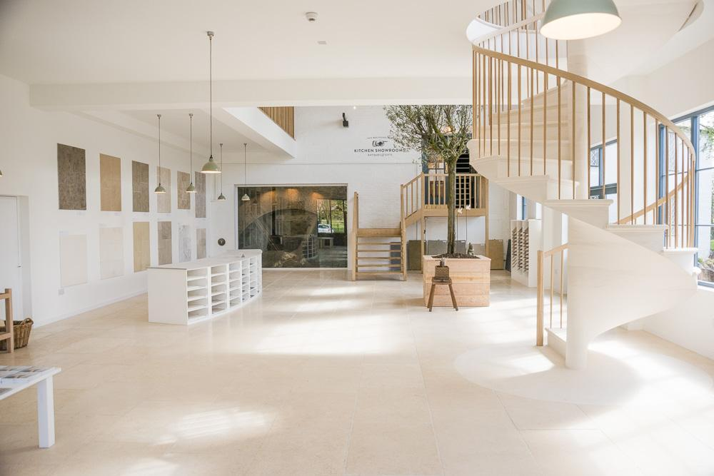 view into the showroom with spiral stone staircase