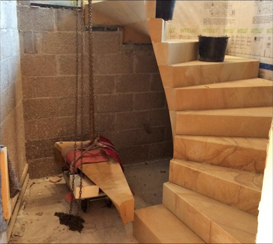 fitting of the cantilevered sandstone staircase