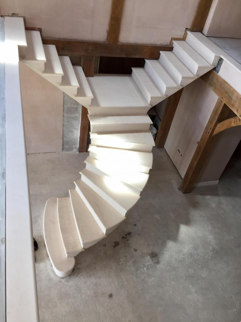 Floating post tensioned stone staircase