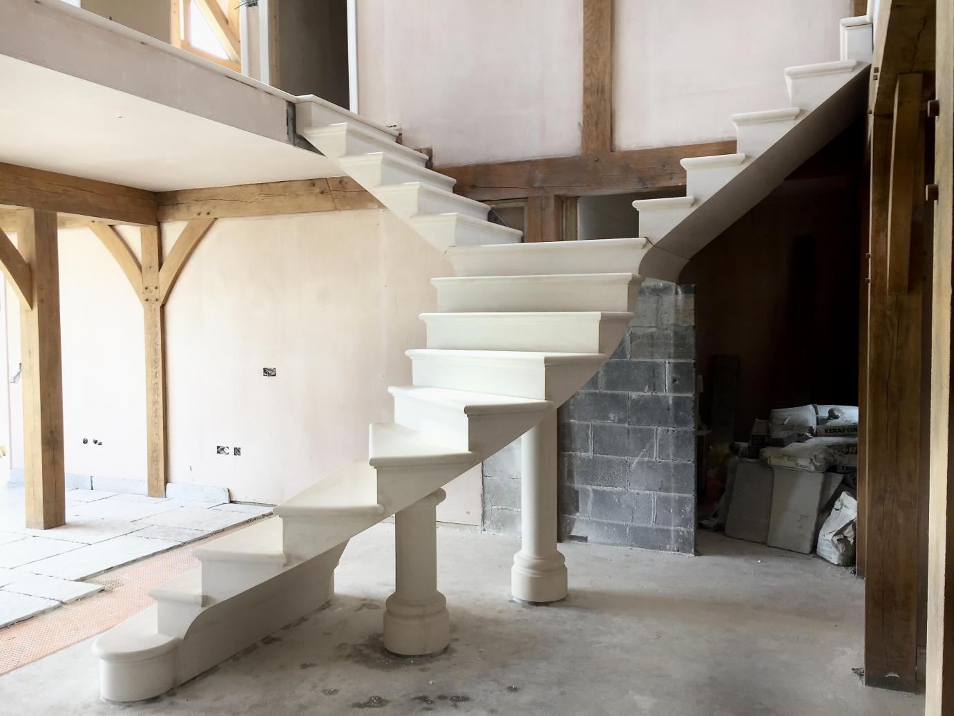 Floating post tensioned stone stair