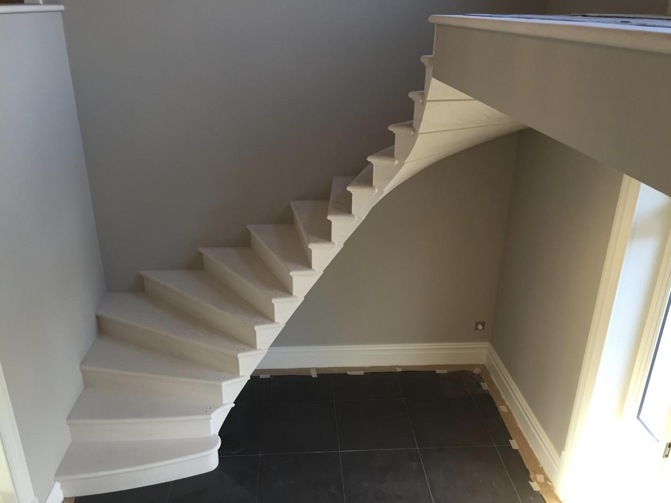 An elegant cantilevered stone staircase Carvero